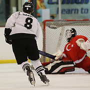 Connor Harrison, New Zealand, scores with a powerful shot beating Turkey goal tender Fikri Atali during the New Zealand V Turkey match during the 2012 IIHF Ice Hockey World Championships Division 3 held at Dunedin Ice Stadium. Dunedin, Otago, New Zealand. 22nd January 2012. Photo Tim Clayton