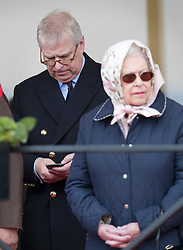 © Licensed to London News Pictures. 11/05/2018. Windsor, UK. Prince Andrew looks at his phone as he stands behind Queen Elizabeth II during the 75th Royal Windsor Horse Show. The five day event takes place in the grounds of Windsor Castle. Photo credit: Peter Macdiarmid/LNP