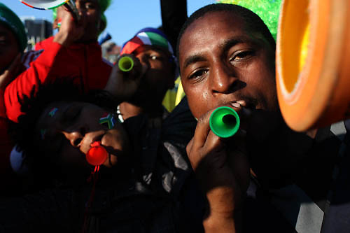 Soccer fans blow their vuvuzelas at the Mary Fritzgerald Square, Newtown Johannesburg, 11 June 2010. Thousands of soccer fans flocked the square to watch the first FIFA World Cup opening match between the South African national team, Bafana Bafana and Mexico.