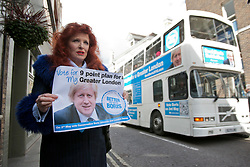 © licensed to London News Pictures. London, UK 10/04/2012. Gloria Martin posing with a Boris Johnson poster after  Boris Jonhson promised 9 Point Plan for Greater London as he launches his campaign to be Mayor of London again, outside Duke Street Church in Richmond, this noon (10/04/12). Photo credit: Tolga Akmen/LNP