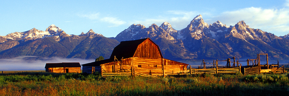 Teton mountains with barn in foreground.