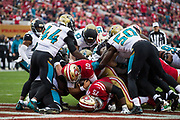 San Francisco 49ers quarterback Jimmy Garoppolo (10) scores a touchdown during the first quarter against the Jacksonville Jaguars at Levi's Stadium in Santa Clara, Calif., on December 24, 2017. (Stan Olszewski/Special to S.F. Examiner)
