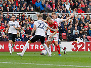Middlesbrough midfielder George Saville (22) goes down after a challenge from Swansea City midfielder George Byers (28)  during the EFL Sky Bet Championship match between Middlesbrough and Swansea City at the Riverside Stadium, Middlesbrough, England on 22 September 2018.