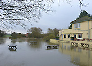 © Licensed to London News Pictures. 26/11/2012. Oxfordshire, UK A The Ferryman pub at the Bablockhythe Caravan and Holiday home park sits in floodwater.  Flooding on the River Thames today 26th November 2012 in Oxfordshire. Photo credit : Stephen Simpson/LNP