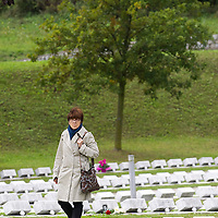 LONGARONE, ITALY - OCTOBER 09:  A woman walks between the graves inside the Cemetery of the Vajont victims on October 9, 2013 in Longarone, Italy. Today is the 50th anniversary of the Vajont disaster, which occurred on 9th October 1963, and is the worst landslide disaster in European history with 2000 people killed.  (Photo by Marco Secchi/Getty Images)