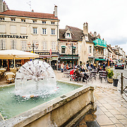 Fountain and outdoor cafe in downtown Beaune