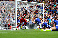 Swansea City take the lead from an own goal by John Terry of Chelsea (2nd right) who holds is head in the ground during the Barclays Premier League match at Stamford Bridge, London<br /> Picture by David Horn/Focus Images Ltd +44 7545 970036<br /> 13/09/2014