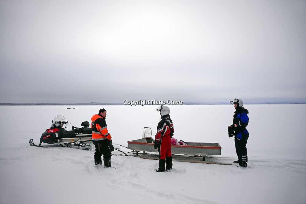 Snowmobile experience through wilderness of Lake Inari with VisitInari, Lapland, Finland
