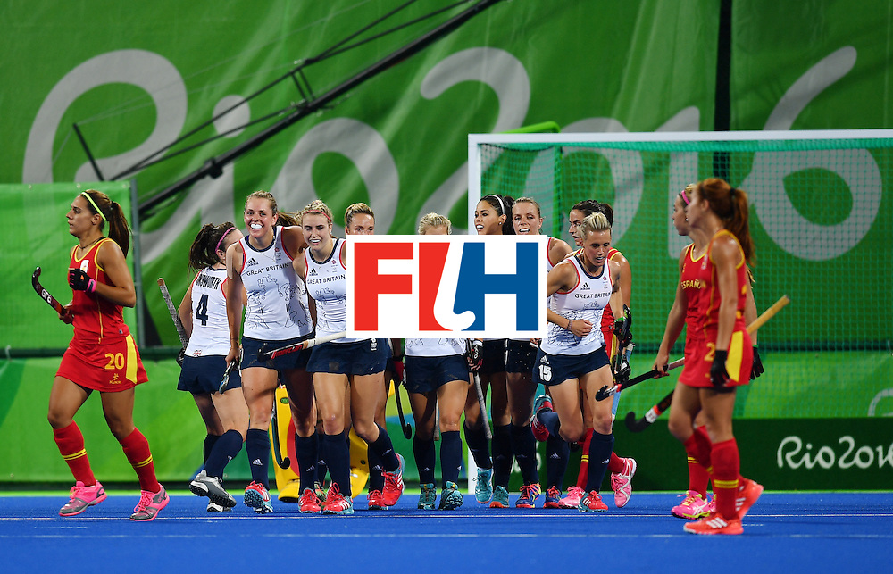 Britain's players celebrate after scoring their third goal during the women's quarterfinal field hockey Britain vs Spain match of the Rio 2016 Olympics Games at the Olympic Hockey Centre in Rio de Janeiro on August 15, 2016. / AFP / MANAN VATSYAYANA        (Photo credit should read MANAN VATSYAYANA/AFP/Getty Images)