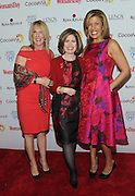 Nancy Brown, center, CEO, American Heart Association, poses with event host Hoda Kotb, right, and honoree Dr. Kathy Magliato, cardiothoracic surgeon and AHA board member, at Woman's Day Red Dress Awards, benefitting AHA's Go Red For Women, Tuesday February 9, 2016, in New York. (Photo by Diane Bondareff/Invision for Go Red For Women/AP Images)