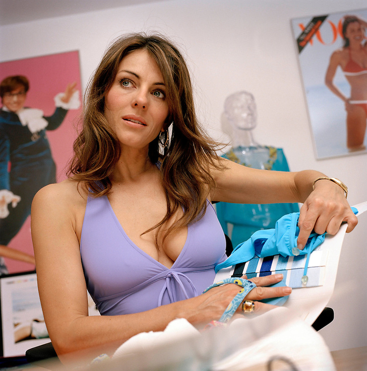 Elizabeth Hurley with her swimwear designs in her studio in South Kensington, London, UK.