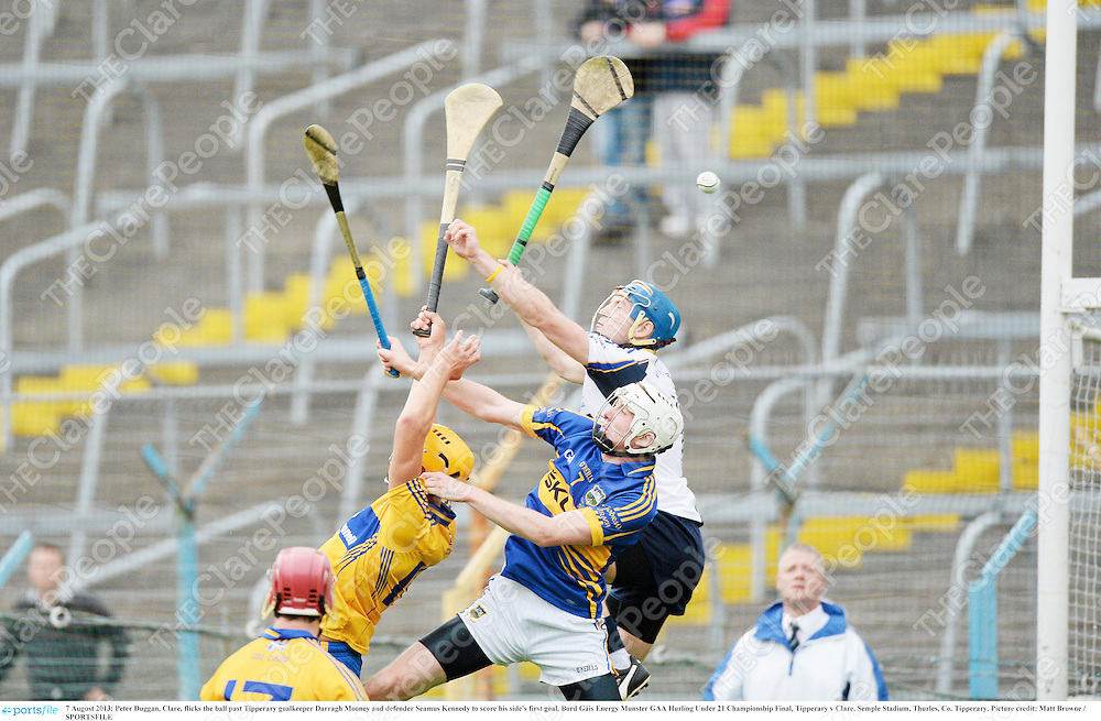 7 August 2013; Peter Duggan, Clare, flicks the ball past Tipperary goalkeeper Darragh Mooney and defender Seamus Kennedy to score his side's first goal. Bord Gáis Energy Munster GAA Hurling Under 21 Championship Final, Tipperary v Clare, Semple Stadium, Thurles, Co. Tipperary. Picture credit: Matt Browne / SPORTSFILE