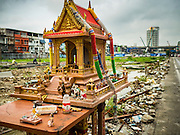 21 SEPTEMBER 2016 - BANGKOK, THAILAND: A Spirit House on the corner of the construction site that used to be the Bang Chak Market. The market closed permanently on January 4, 2016. The Bang Chak Market served the community around Sois 91-97 on Sukhumvit Road in the Bangkok suburbs. Bangkok city authorities put up notices in late November 2015 that the market would be closed by January 1, 2016 and redevelopment would start shortly after that. Market vendors said condominiums are being built on the land.      PHOTO BY JACK KURTZ