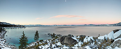 """Sand Harbor Sunrise 2"" - Stiched Panoramic photograph of Sand Harbor in the distance shot at sunrise, the moon can be seen in the photo."