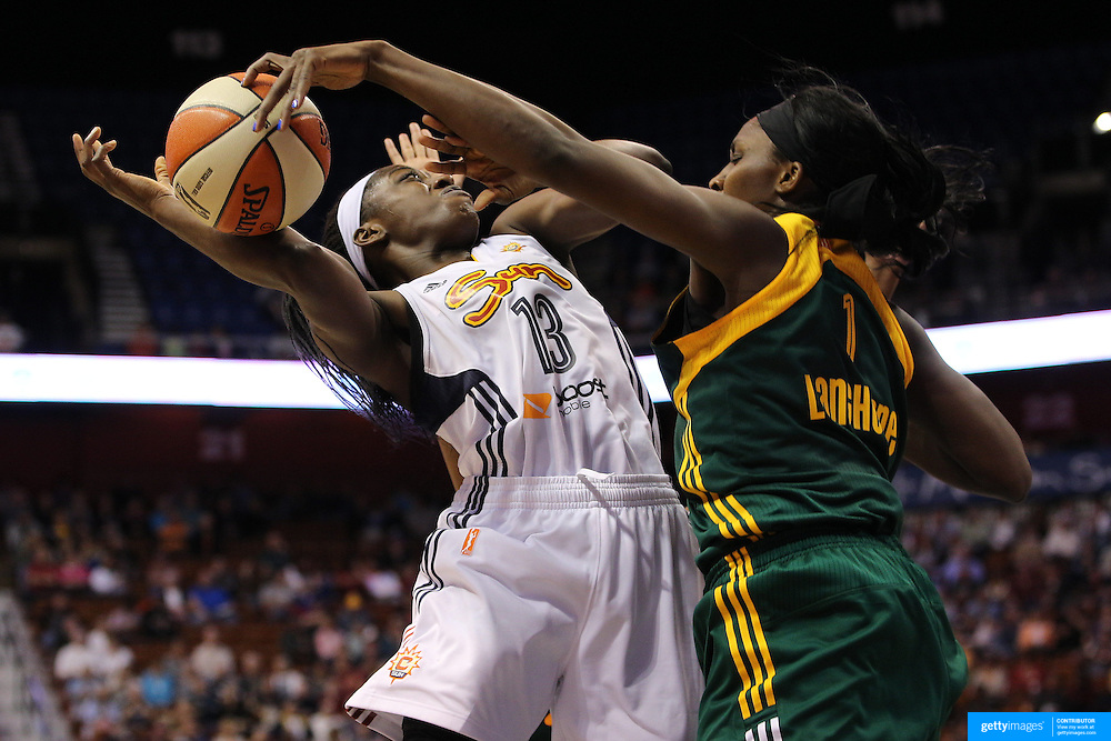Chiney Ogwumike, (left), Connecticut Sun, has her shot blocked by Crystal Langhorne, Seattle Storm, during the Connecticut Sun Vs Seattle Storm WNBA regular season game at Mohegan Sun Arena, Uncasville, Connecticut, USA. 23rd May 2014. Photo Tim Clayton