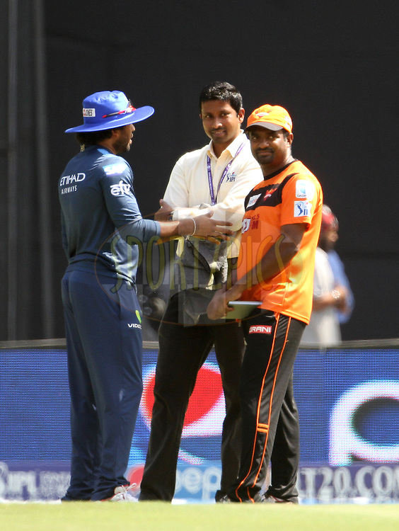 Mumbai Indians player Lasith Malinga speaks with SunRisers Hyderabad bowling coach Muttiah Muralitharan and commentator Russel Arnold before the start of the match 23 of the Pepsi IPL 2015 (Indian Premier League) between The Mumbai Indians and The Sunrisers Hyderabad held at the Wankhede Stadium in Mumbai India on the 25th April 2015.<br /> <br /> Photo by:  Vipin Pawar / SPORTZPICS / IPL