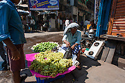 Man selling grapes in Kolkata (India).