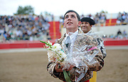 BEA AHBECK/NEWS-SENTINEL<br /> Aposento de Turlock's Emmanuel Peichoto thanks the crowd after grabbing the first bull during the bloodless bullfight during the Our Lady of Fatima Portuguese Festival in Thornton Saturday, Oct. 15, 2016.