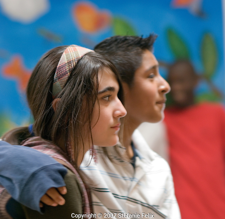 Couple of secondary students wait for dress rehearsal for a Shakespeare play they will perform