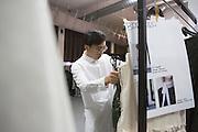 Miaoran, fashion designer, at work in the Backstage of his fashion show at Armani Teatro, Milan June 18, 2016. © Carlo Cerchioli