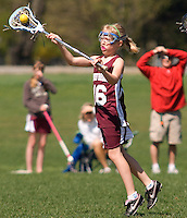 Catherine McLaughlin makes a pass during U11 Lakes Region Lacrosse matchup with Wyndham held Sunday, Mother's Day at the meadows field in Gilford. (Karen Bobotas Photographer)