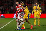 Doncaster Rovers defender Danny Andrew (3) battles with Crystal Palace midfielder James McArthur (18) during the The FA Cup 5th round match between Doncaster Rovers and Crystal Palace at the Keepmoat Stadium, Doncaster, England on 17 February 2019.
