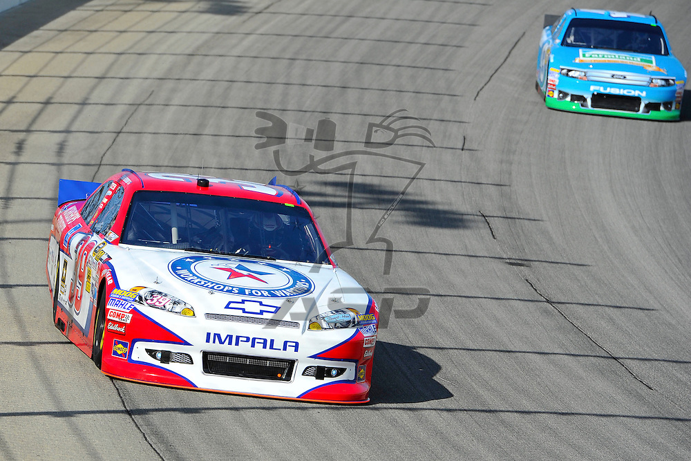 Joliet, IL - SEP 14, 2012: Ryan Newman (39) in turn 4 during practice for the Geico 400 at the Chicagoland Speedway in Joliet, IL.