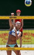 Nikki Moreland (NZ) smashes the ball over at the NZ Beach Volleyball Open at Stanley St, Auckland, New Zealand on Friday 20 January, 2006. Photo: Hannah Johnston/PHOTOSPORT<br />