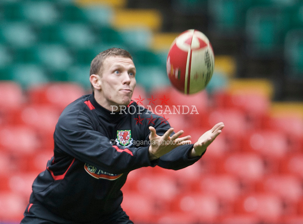 CARDIFF, WALES - Thursday, March 26, 2009: Wales' captain Craig Bellamy plays with a rugby ball during training at the Millennium Stadium ahead of the 2010 FIFA World Cup Qualifying Group 4 match against Finland. (Pic by David Rawcliffe/Propaganda)