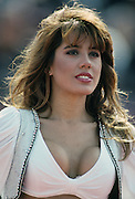 A Los Angeles Raiders cheerleader performs during the NFL football game between the Seattle Seahawks and the Oakland Raiders on October 10, 1990 in Los Angeles, California. The Raiders won the game 24-17. ©Paul Anthony Spinelli