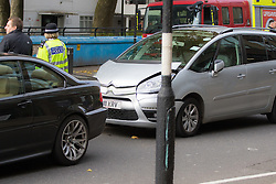 Ladbroke Grove, London, November 17th 2016. A double decker bus crashes into Kensal House on Ladbroke Grove prompting a major response from the emergency services including the air ambulance. According to Detective Chief Superintendent Ellie O'Connor of Met Police Kensington and Chelsea, 14 people including the driver were hurt, with none sustaining life-threatening or life changing injuries. Police officers would not speculate on the cause of the accident, but apologised for delays and commended all branches of the emergency services for their prompt and efficient response. The bus will be towed away for further investigations. PICTURED: Two cars at the scene appear to have been involved in a minor collision. Police would not speculate on whether they were involved in the bus crash.