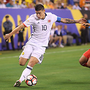 EAST RUTHERFORD, NEW JERSEY - JUNE 17:  James Rodriguez #10 of Colombia is challenged by Miguel Trauco #6 of Peru during the Colombia Vs Peru Quarterfinal match of the Copa America Centenario USA 2016 Tournament at MetLife Stadium on June 17, 2016 in East Rutherford, New Jersey. (Photo by Tim Clayton/Corbis via Getty Images)