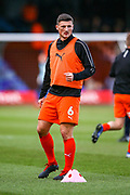 Luton Town defender Matthew Person warms up before the EFL Sky Bet League 1 match between Luton Town and Wycombe Wanderers at Kenilworth Road, Luton, England on 9 February 2019.