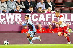 Aaron Lennon of Burnley goes past Konstantinos Tsimikas of Olympiakos - Mandatory by-line: Robbie Stephenson/JMP - 30/08/2018 - FOOTBALL - Turf Moor - Burnley, England - Burnley v Olympiakos - UEFA Europa League Play-offs second leg