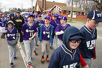 Players from VFW and Elks march down North Main Street towards Colby Field for opening day ceremonies for Laconia Little League Saturday morning.  (Karen Bobotas/for the Laconia Daily Sun)