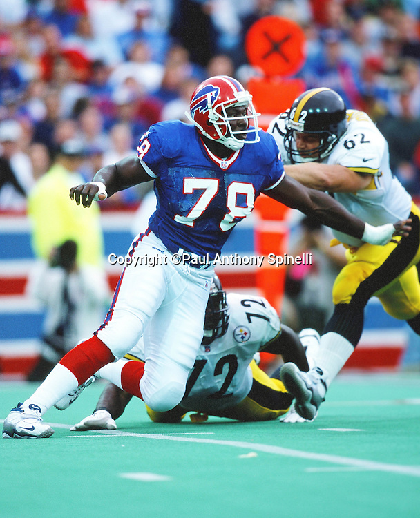 Buffalo Bills defensive end Bruce Smith (78) works his way past a double team block by Pittsburgh Steelers center Roger Duffy (62) and Steelers offensive tackle Wayne Gandy (72) during the NFL football game against the Pittsburgh Steelers on Oct. 10, 1999 in Orchard Park, N.Y. The Bills won the game 24-21. (©Paul Anthony Spinelli)