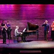 January 14, 2012 - Brooklyn, NY : .Back row from left, pianist Miori Sugiyama, mezzo-soprano Mary Nessinger, soprano Emily Riggs, pianist Michael Rose, pianist Michael Brofman, tenor Brandon Snook, soprano Deborah van Renterghem, tenor Paul Sperry, and bass-baritone Robert Osborne, perform on kazoos as Jodie Rottle, standing front at left, plays her flute and Marc Peloquin, sitting at center, plays piano during a marathon celebration of Charles Ives at the Galapagos Art Space in DUMBO, Brooklyn, on Saturday evening..CREDIT: Karsten Moran for The New York Times