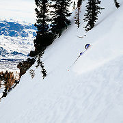 Hadley Hammer makes high speed powder turns in the Teton backcountry near Jackson Hole Mountain Resort.