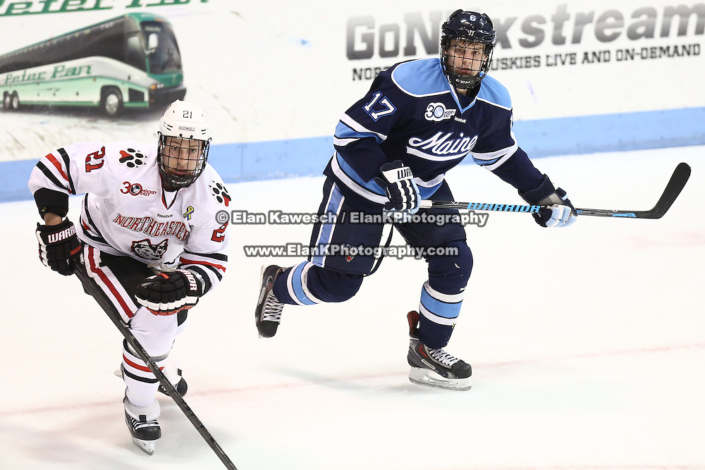 Andrew Tegeler #17 of the Maine Black Bears and Zak Stone #21 of the Northeastern Huskies on the ice during the game at Matthews Arena on February 22, 2014 in Boston, Massachusetts. (Photo by Elan Kawesch)