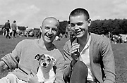 Two Skinheads with a small dog at Ashton Court Festival, 1985