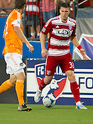 FRISCO, TX - JUNE 12:  Kenny Cooper #33 of FC Dallas brings the ball up field against Bobby Boswell #32 of Houston Dynamo on June 12, 2013 at FC Dallas Stadium in Frisco, Texas.  (Photo by Cooper Neill/Getty Images) *** Local Caption *** Kenny Cooper; Bobby Boswell