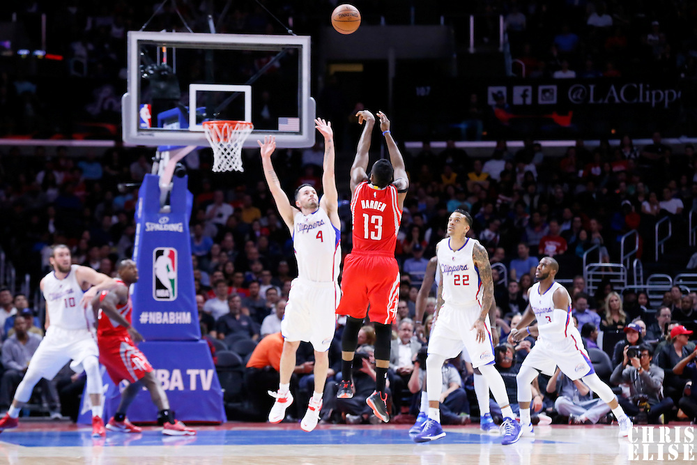 11 February 2015: Houston Rockets guard James Harden (13) takes a jump shot over Los Angeles Clippers guard J.J. Redick (4) during the Los Angeles Clippers 110-95 victory over the Houston Rockets, at the Staples Center, Los Angeles, California, USA.