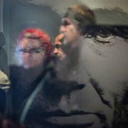 WASHINGTON, DC - FEB12: Visitors pass by a reflection of President Lincoln and are reflected in the glass doorway in the small Lincoln Memorial museum,  February 12, 2016. The area below the memorial which houses the museum, bathrooms, and elevator, will be expanded and refurbished. The memorial will also be repaired with the help of a gift from David Rubenstein, who is giving $18.5 million to the National Park Service, to refurbish the Lincoln Memorial. (Photo by Evelyn Hockstein/For The Washington Post)
