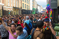 Portland Place, London, June 25th 2016. Thousands of LGBT people and their supporters gather for Pride in London, a colourful celebration of the hard-won rights of lesbian, gay, bisexual and transgender  people. PICTURED: Thousands of people pack the streets of Soho.