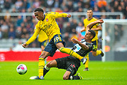Isaac Hayden (#14) of Newcastle United FC tackles Joe Willock (#28) of Arsenal FC during the Premier League match between Newcastle United and Arsenal at St. James's Park, Newcastle, England on 11 August 2019.
