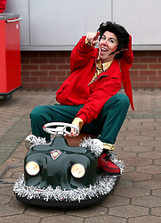 A person dressed as an elf rides on a small cart during the Premier League match at St Mary's, Southampton.
