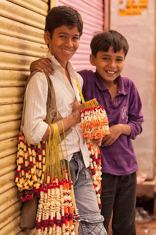 "Two boys sell beads  in the ""galis"" (alley ways) of the Old City of Varanasi India."