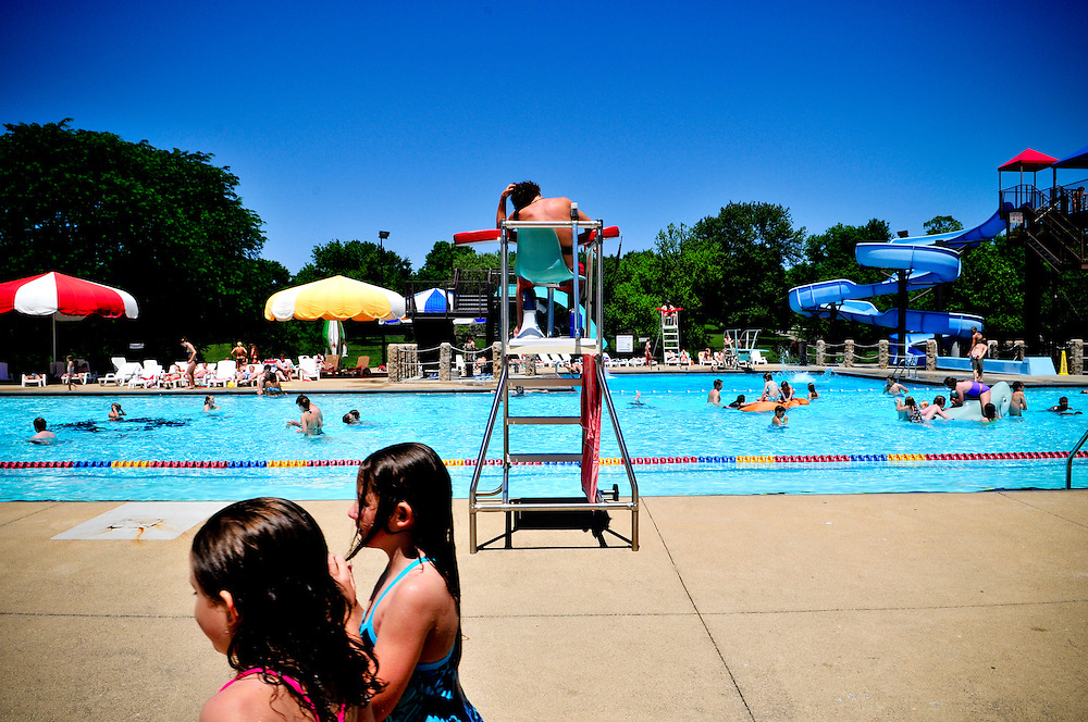 A lifeguard keeps watch at Bryan Park Pool in Bloomington, Indiana.