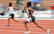 Two girls run around the track during the 400 meter race at the Burlington County Track and Field Open Championship Boys and Girls at Rancocas Valley High School Saturday May 21, 2016 in Rancocas, New Jersey. (Photo by William Thomas Cain)