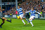 Queens Park Rangers defender Jake Bidwell (3) crosses towards the goal during the EFL Sky Bet Championship match between Queens Park Rangers and Reading at the Loftus Road Stadium, London, England on 29 December 2018.